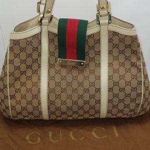 Gucci Sukey Monogram with iconic web belt closure
